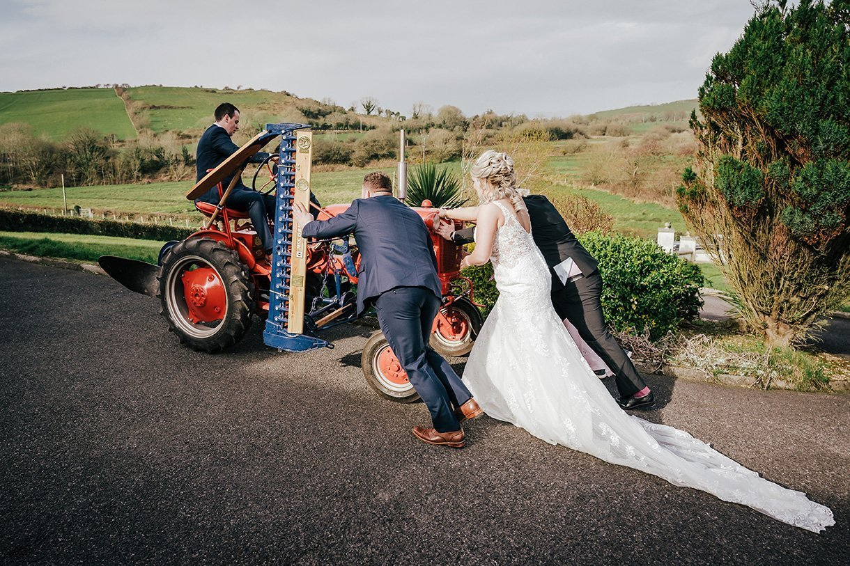 Sandhouse Hotel Rossnowlagh Wedding bride pushes broken down tractor