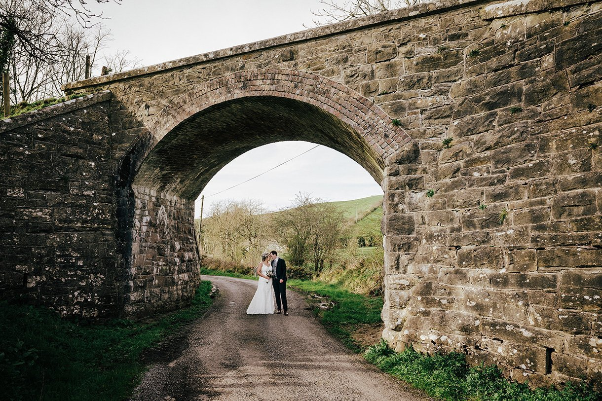 Sandhouse Hotel Rossnowlagh Wedding bride and groom under old railway bridge photo
