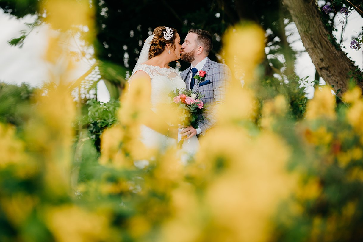 Great Northern Hotel Bundoran Summer Wedding bride and groom kiss in summer garden