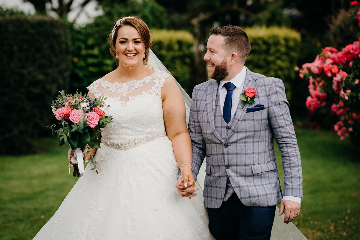 Great Northern Hotel Bundoran Summer Wedding bride and groom hold hands