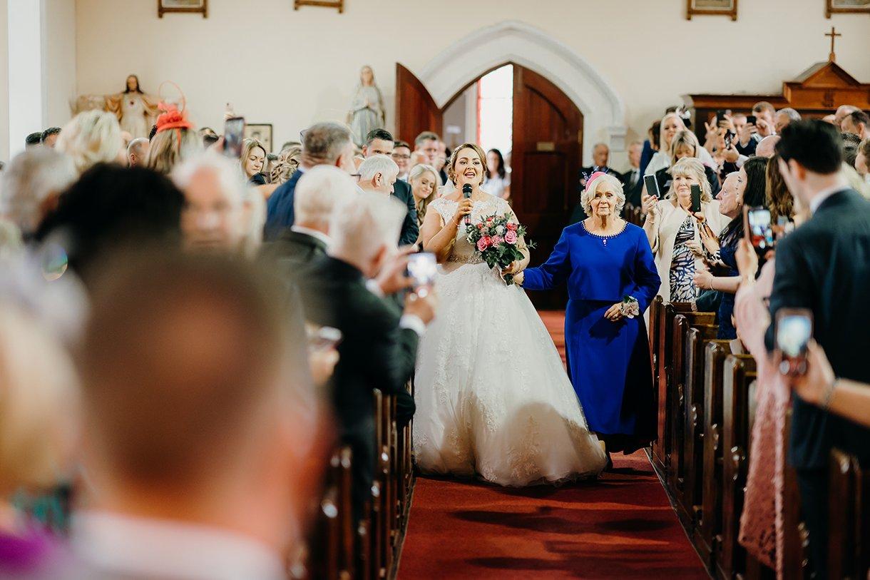Great Northern Hotel Bundoran Summer Wedding bride sings down the aisle at her wedding