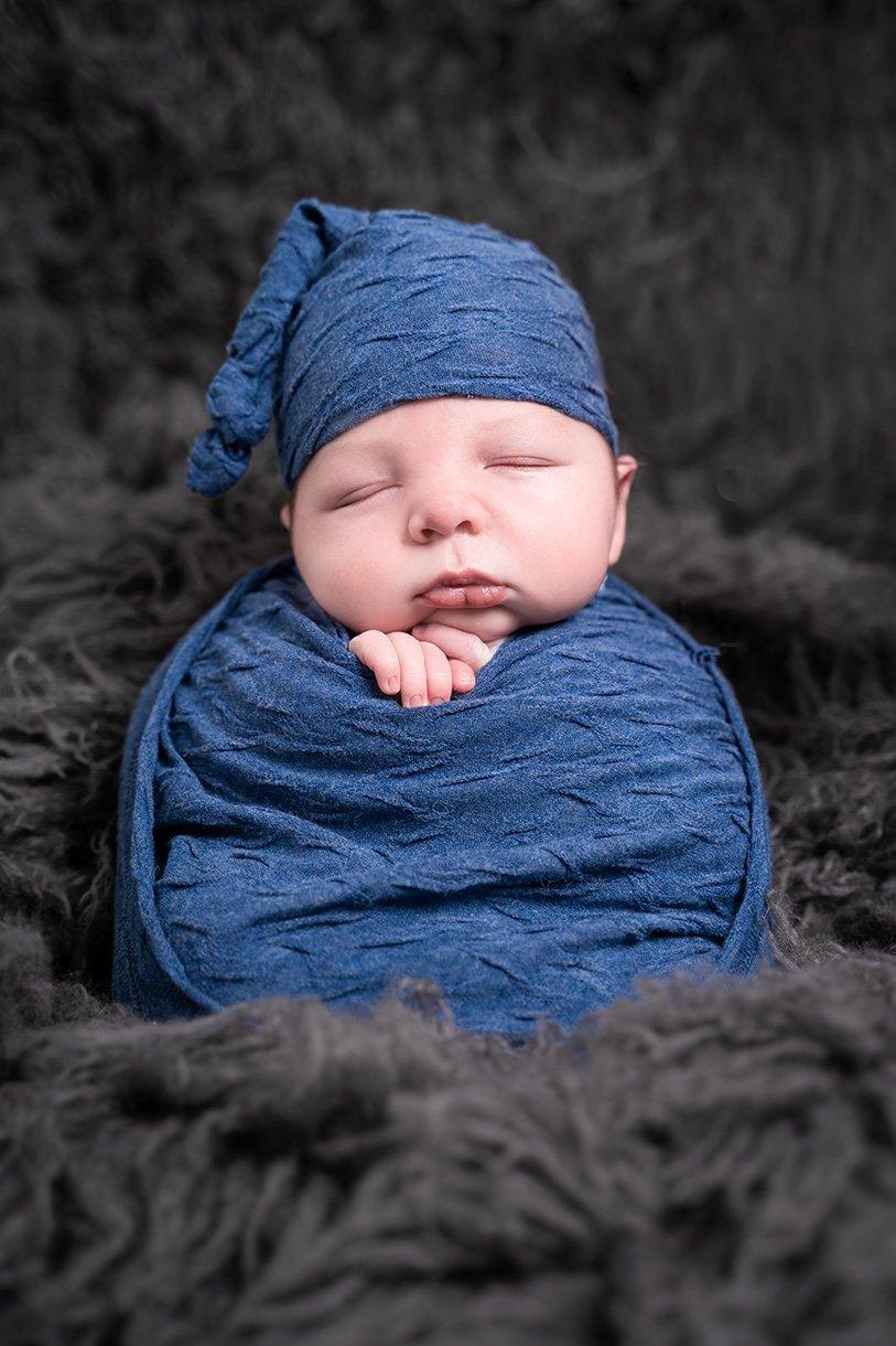 potato sack pose newborn baby boy