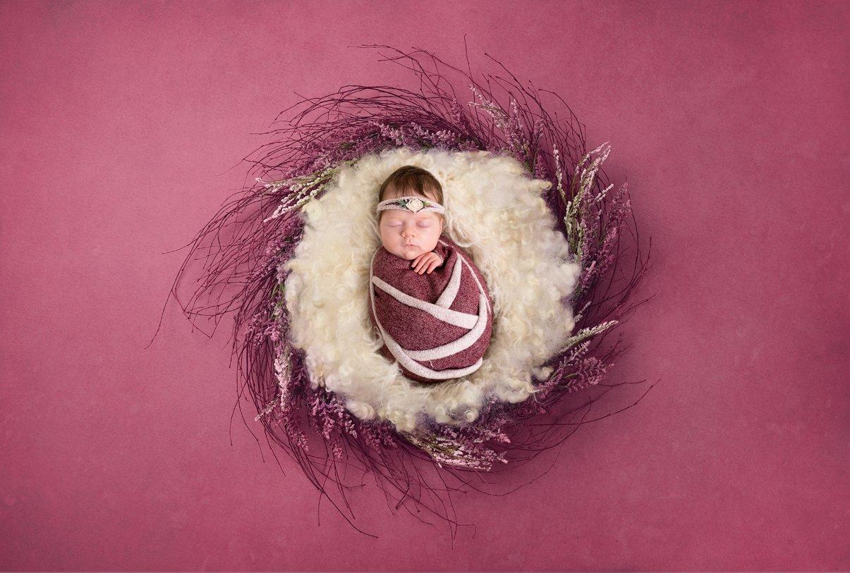 newborn girl photo in a flower basket